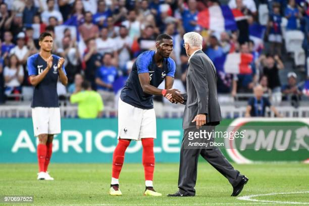 Paul Pogba shakes hand with Former France World Cup Winning coach Aime Jacquet during the International Friendly match between France and United...