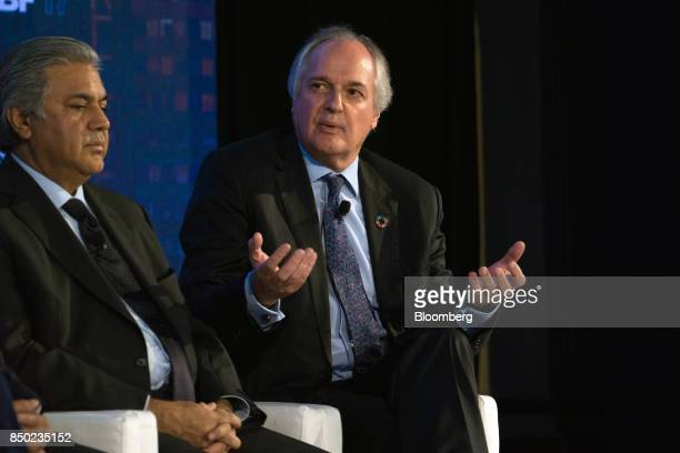 Paul Polman chief executive officer of Unilever NV right speaks while Arif Naqvi chief executive officer of Abraaj Capital Ltd listens during the...