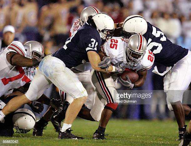 Paul Posluszny and Matthew Rice of the Penn State Nittany Lions tackle Antonio Pittman of the Ohio State Buckeyes during their game October 8 2005 at...