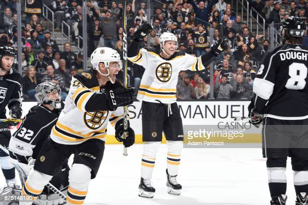 Paul Postma and Jordan Szwarz of the Boston Bruins celebrate a goal against the Los Angeles Kings at STAPLES Center on November 16 2017 in Los...
