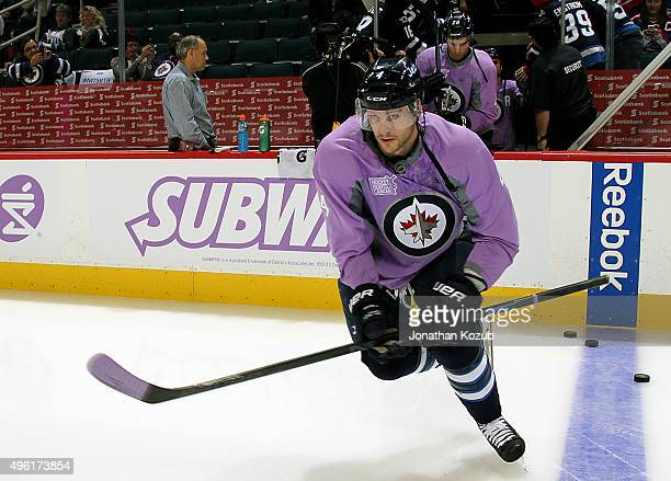 5cfbfe476 Paul Postma of the Winnipeg Jets hits the ice for the pregame warm up  sporting a