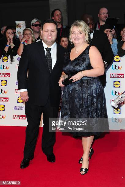 Paul Potts and wife Julie-Ann Potts arriving at the 2013 Pride of Britain awards at Grosvenor House, London.