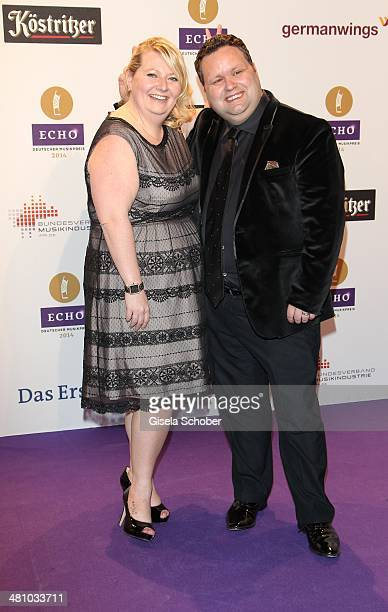 Paul Potts and wife JulieAnn Potts pose on the red carpet prior the Echo award 2014 at Messe Berlin on March 27 2014 in Berlin Germany