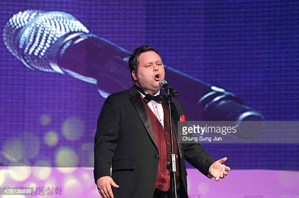 Paul Potts performs at the One Chance premiere at Times Square on March 5 2014 in Seoul South Korea The 'One Chance' which will be released in South...