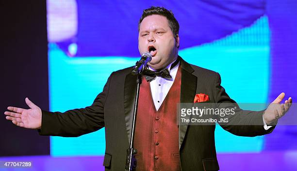 Paul Potts performs onstage during the movie 'One Chance' day event at Times Square on March 5 2014 in Seoul South Korea