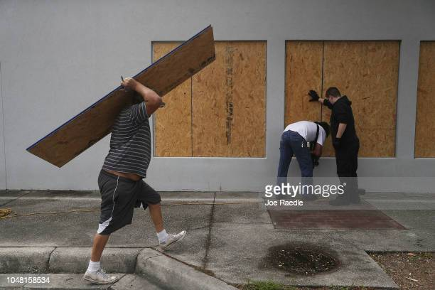 Paul Potts Sr Al Smith and Paul Potts put plywood over the windows of a building as they prepare it for the arrival of Hurricane Michael on October 9...