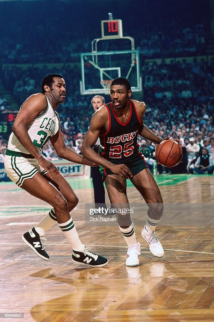 Paul Pressey #25 of the Milwaukee Bucks drives against M.L. Carr #30 of the Boston Celtics during a game played in 1983 at the Boston Garden in Boston, Massachusetts.