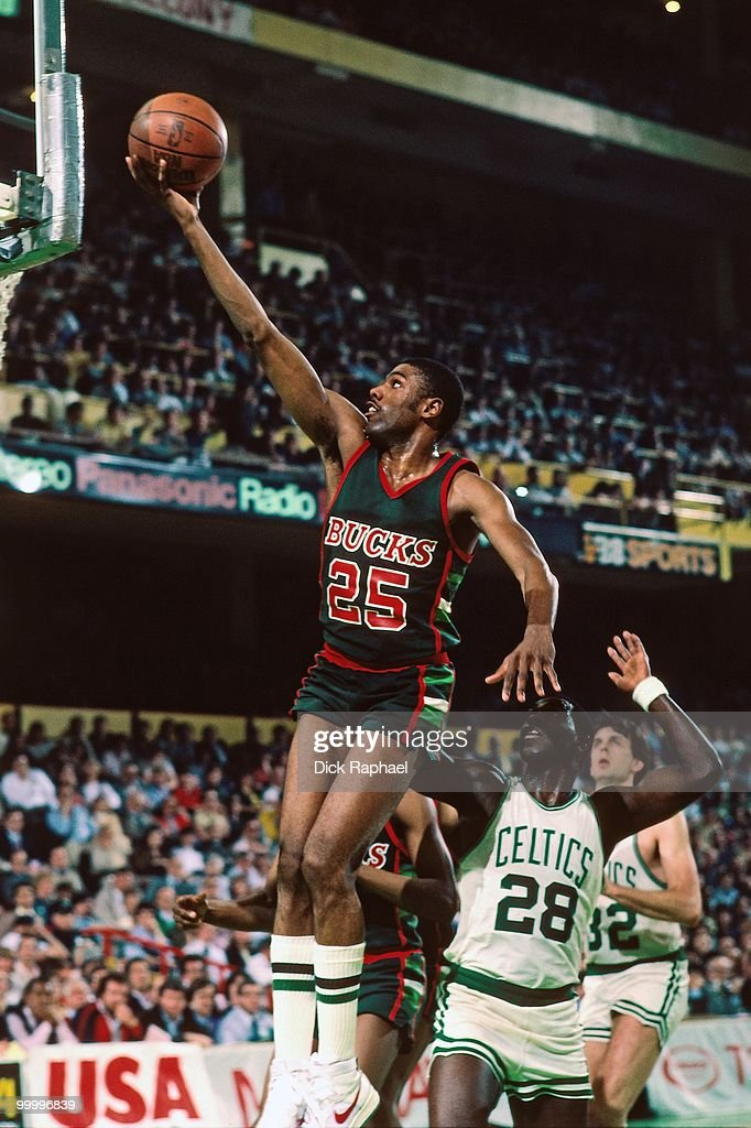 Paul Pressey #25 of the Milwaukee Bucks shoots a layup against Quinn Buckner #28 of the Boston Celtics during a game played in 1983 at the Boston Garden in Boston, Massachusetts.