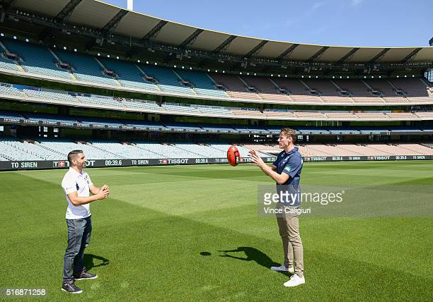 Paul Puopolo of Hawthorn and Mark Blicavs of Geelong pose in front of the new Tissot LED countdown timing display at Melbourne Cricket Ground on...