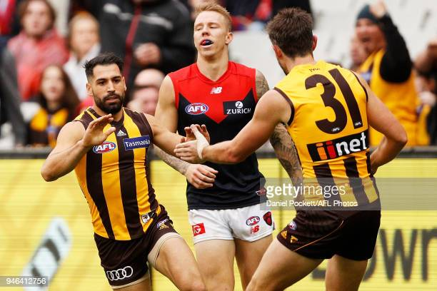 Paul Puopolo of the Hawks celebrates a goal during the round four AFL match between the Hawthorn Hawks and the Melbourne Demons at Melbourne Cricket...