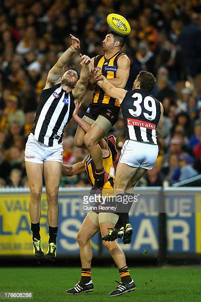 Paul Puopolo of the Hawks flies for a mark during the round 21 AFL match between the Hawthorn Hawks and the Collingwood Magpies at Melbourne Cricket...