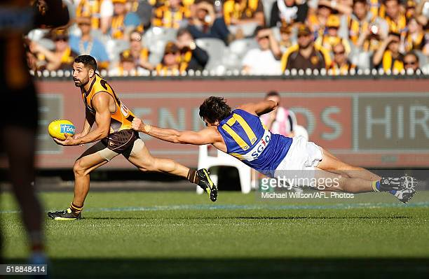 Paul Puopolo of the Hawks is tackled by Josh Kennedy of the Eagles during the 2016 AFL Round 02 match between the Hawthorn Hawks and the West Coast...