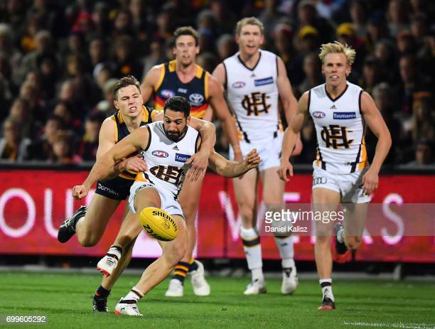 Paul Puopolo of the Hawks kicks the ball during the round 14 AFL match between the Adelaide Crows and the Hawthorn Hawks at Adelaide Oval on June 22...