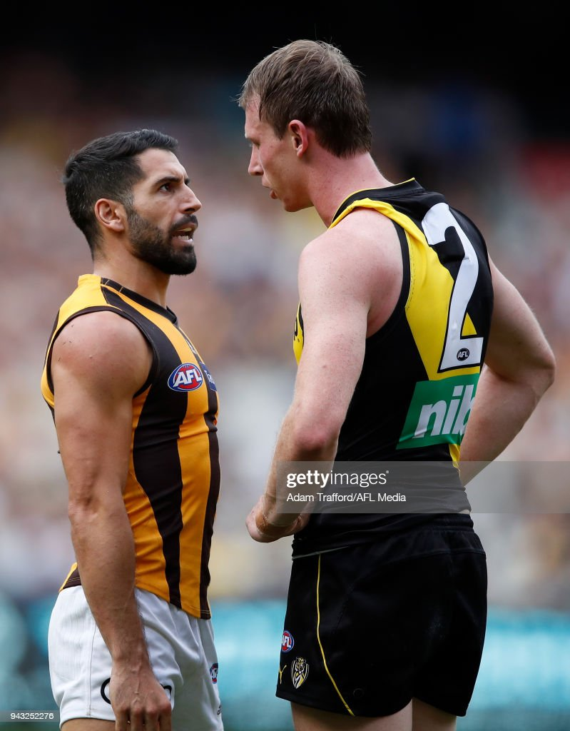 Paul Puopolo of the Hawks remonstrates with Dylan Grimes of the Tigers after kicking a goal from a free kick paid to him for a high tackle during the 2018 AFL round 03 match between the Richmond Tigers and the Hawthorn Hawks at the Melbourne Cricket Ground on April 8, 2018 in Melbourne, Australia.