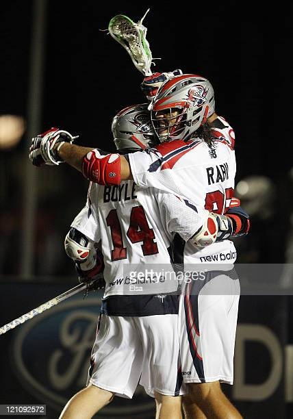 Paul Rabil and Ryan Boyle of the Boston Cannons celebrate the win in overtime on August 13, 2011 at Harvard Stadium in Cambridge, Massachusetts. The...