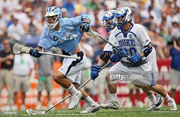 Paul Rabil of Johns Hopkins gets pulled from behind by Terrence Molinari of Duke on May 28 2007 at MT Bank Stadium in Baltimore Maryland in the NCAA...