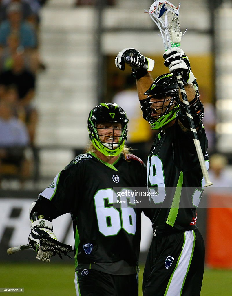 Paul Rabil #99 of the New York Lizards reacts with Matt Gibson #66 during the 2015 Major League Lacrosse Championship Game against the Rochester Rattlers at Fifth Third Bank Stadium on August 8, 2015 in Kennesaw, Georgia.