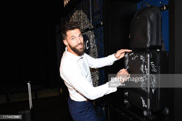 Paul Rabin signs a Montblanc Trolley at the Laureus Fashion Show Gala during NYFW on September 10 2019 at Mercedes Benz Manhattan at MercedesBenz...