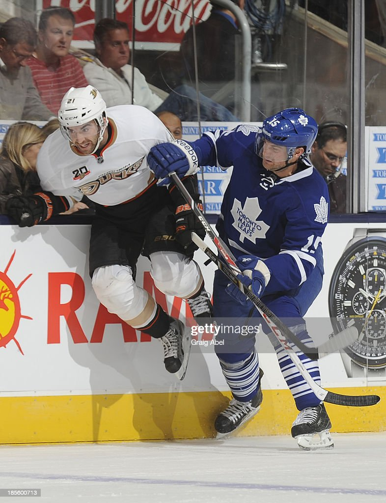 Paul Ranger #15 of the Toronto Maple Leafs checks Kyle Palmieri #21 of the Anaheim Ducks during NHL game action October 22, 2013 at Air Canada Centre in Toronto, Ontario, Canada.