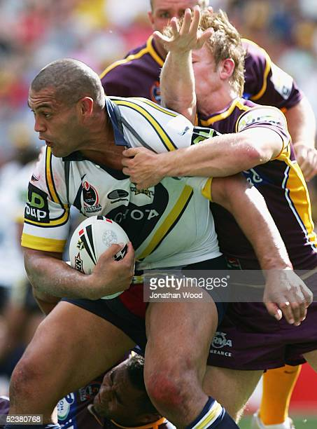 Paul Rauhihi of the Cowboys looks to offload during the first round NRL match between the Brisbane Broncos and North Queensland Cowboys at Suncorp...