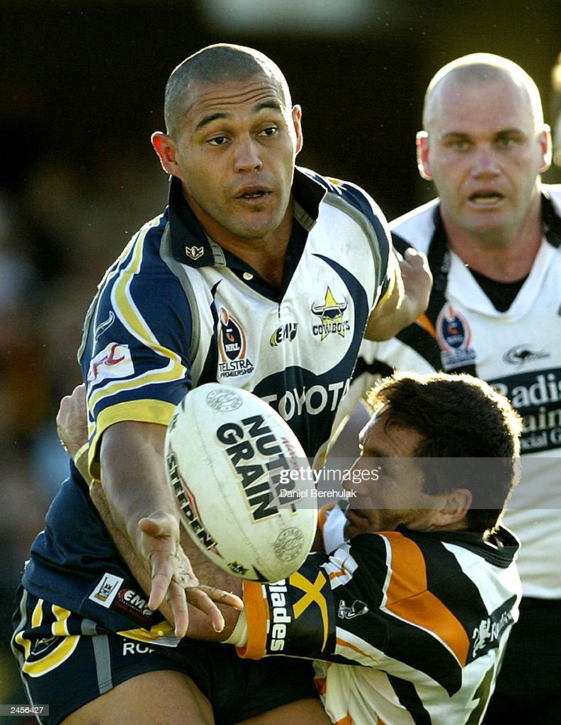 Paul Rauhihi #8 of the Cowboys offloads the ball during the round 25 NRL match between the Wests Tigers and the North Queensland Cowboys at Campbelltown Oval August 31, 2003 in Sydney, Australia.