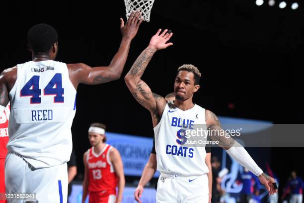 Paul Reed high-fives Rayjon Tucker of the Delaware Blue Coats during the game on March 6, 2021 at AdventHealth Arena in Orlando, Florida. NOTE TO...