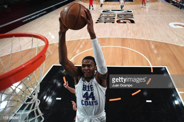 Paul Reed of the Delaware Blue Coats dunks the ball against the Memphis Hustle on March 6, 2021 at AdventHealth Arena in Orlando, Florida. NOTE TO...