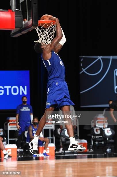 Paul Reed of the Delaware Blue Coats dunks the ball against the Santa Cruz Warriors on February 12, 2021 at AdventHealth Arena in Orlando, Florida....
