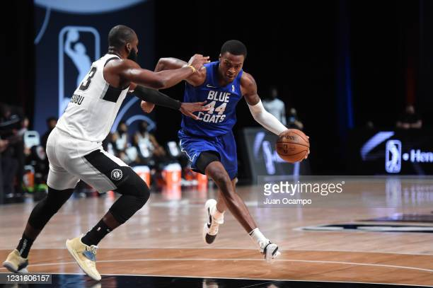 Paul Reed of the Delaware Blue Coats handles the ball against the Austin Spurs during the NBA G League Playoffs on March 8, 2021 at AdventHealth...