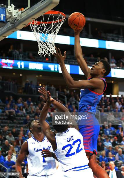 Paul Reed of the DePaul Blue Demons in action as Michael Nzei and Myles Cale of the Seton Hall Pirates defend during a game at Prudential Center on...