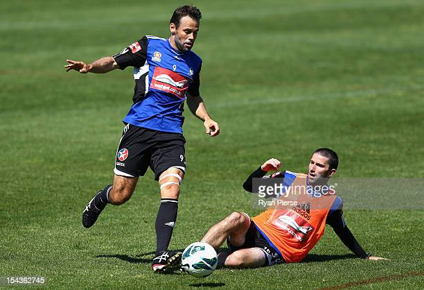 Paul Reid of Sydney FC is tackled by Terry McFlynn of Sydney FC during a Sydney FC Training Session at Macquarie Uni on October 19, 2012 in Sydney,...