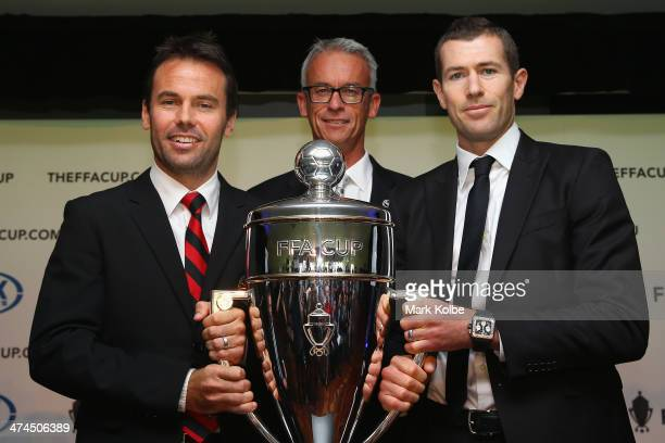 Paul Reid of the Rockdale City Suns FFA CEO David Gallop and former Socceroos Brett Emerton pose with the FFA Cup trophy during the FFA Cup launch at...