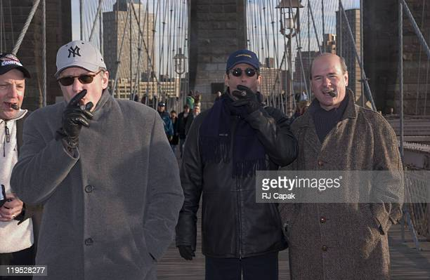 Paul Reiser Jerry Seinfeld and Larry Miller have their Traditional New Years Day walk across the Brooklyn Bridge while enjoying their cigars