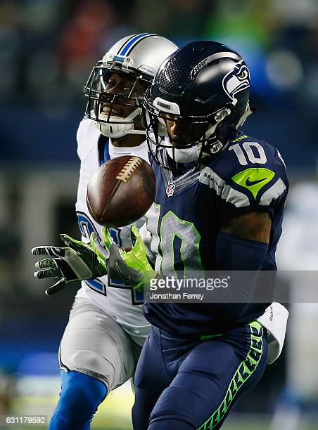 Paul Richardson of the Seattle Seahawks attempts to make a reception against Nevin Lawson of the Detroit Lions during the second half of the NFC Wild...