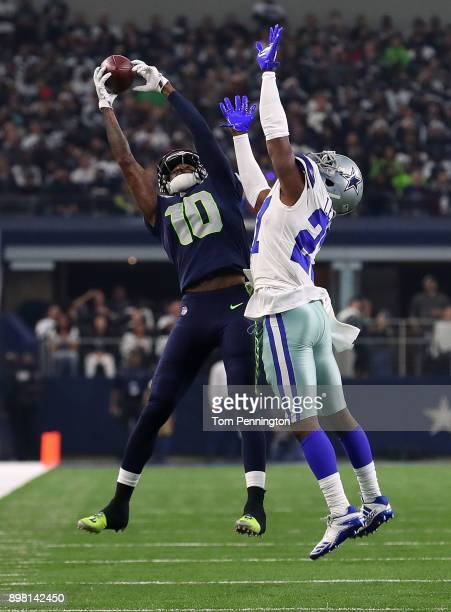 Paul Richardson of the Seattle Seahawks catches a pass against Jourdan Lewis of the Dallas Cowboys in the second half of a football game at ATT...