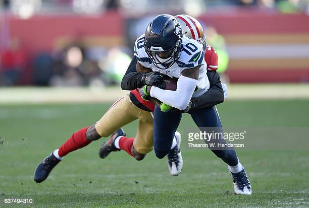 Paul Richardson of the Seattle Seahawks catches a pass and gets tackled by Rashard Robinson of the San Francisco 49ers during the second quarter of...