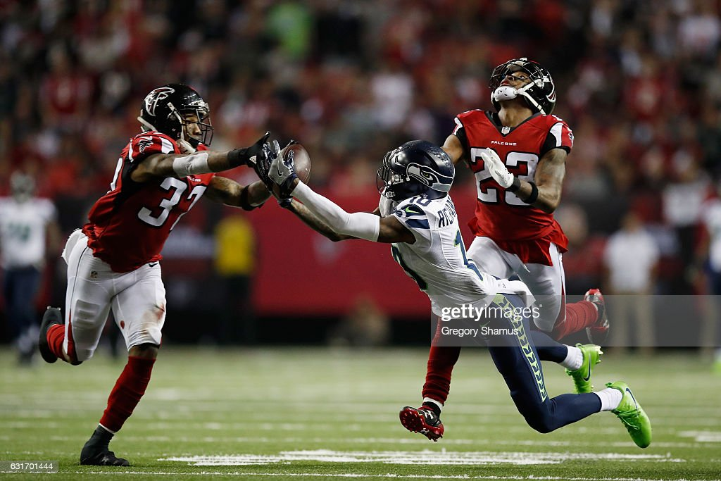 Paul Richardson #10 of the Seattle Seahawks fails to catch the ball against Robert Alford #23 and Ricardo Allen #37 of the Atlanta Falcons at the Georgia Dome on January 14, 2017 in Atlanta, Georgia.
