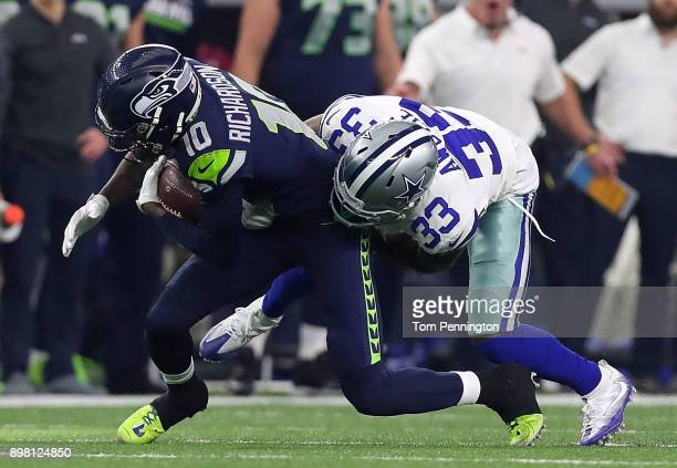 Paul Richardson of the Seattle Seahawks is tackled by Chidobe Awuzie of the Dallas Cowboys in the first quarter of a football game at ATT Stadium on...