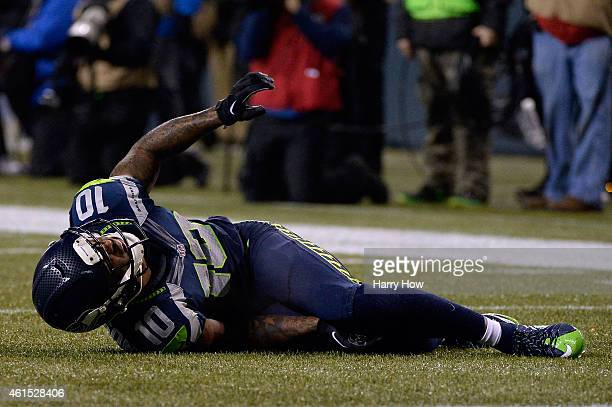 Paul Richardson of the Seattle Seahawks lays on the ground injured against the Carolina Panthers during the 2015 NFC Divisional Playoff game at...