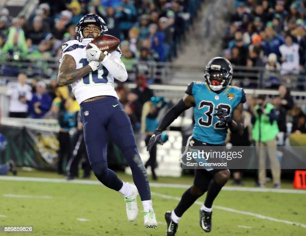 Paul Richardson of the Seattle Seahawks makes a catch in front of Tashaun Gipson of the Jacksonville Jaguars during the second half of their game at...