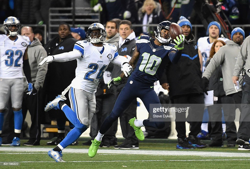 Paul Richardson #10 of the Seattle Seahawks makes a one-handed reception against Nevin Lawson #24 of the Detroit Lions during the second half of the NFC Wild Card game at CenturyLink Field on January 7, 2017 in Seattle, Washington.