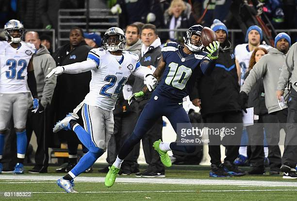 Paul Richardson of the Seattle Seahawks makes a onehanded reception against Nevin Lawson of the Detroit Lions during the second half of the NFC Wild...