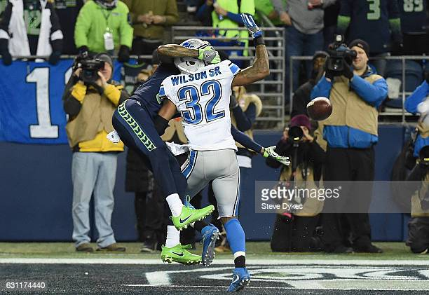 Paul Richardson of the Seattle Seahawks makes a touchdown catch against Tavon Wilson of the Detroit Lions during the second quarter of the NFC Wild...