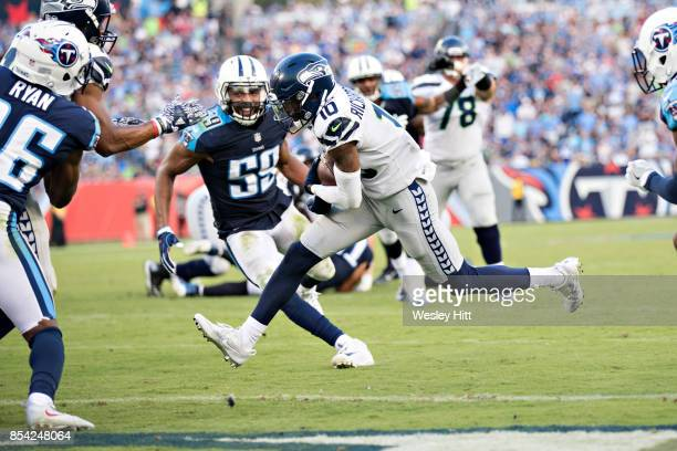 Paul Richardson of the Seattle Seahawks runs a pass in for a touchdown during a game against the Tennessee Titans at Nissan Stadium on September 24...