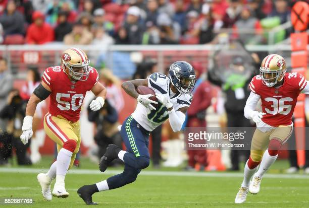 Paul Richardson of the Seattle Seahawks runs with the ball after catching a pass against the San Francisco 49ers during their NFL football game at...