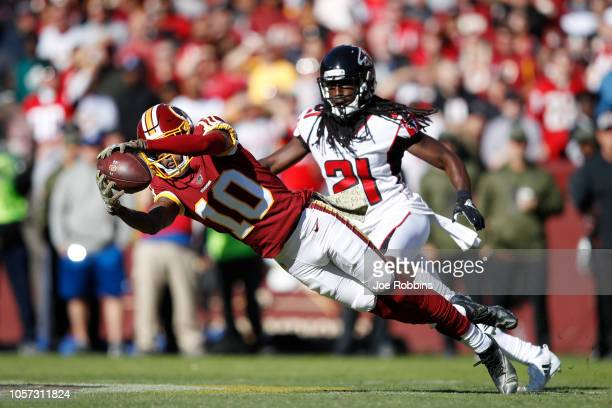 Paul Richardson of the Washington Redskins makes a catch in front of Desmond Trufant of the Atlanta Falcons in the first quarter of the game at...