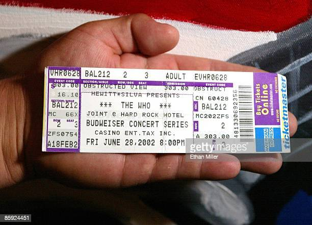 Paul Rimpela of Michigan displays his ticket for a concert by The Who at the Hard Rock Hotel Casino June 28 2002 in Las Vegas Nevada The show was to...