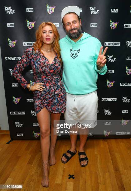 Paul Ripke and Palina Rojinski attend the Paul Ripke Rooftop Event during the Berlin Fashion Week Spring/Summer 2020 at ewerk on July 06 2019 in...