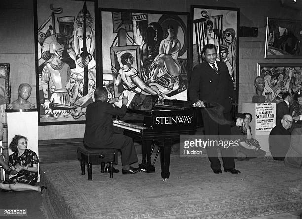 Paul Robeson American singer actor athlete and civil rights campaigner giving a performance in aid of refugee artists at the 20th Century German Art...