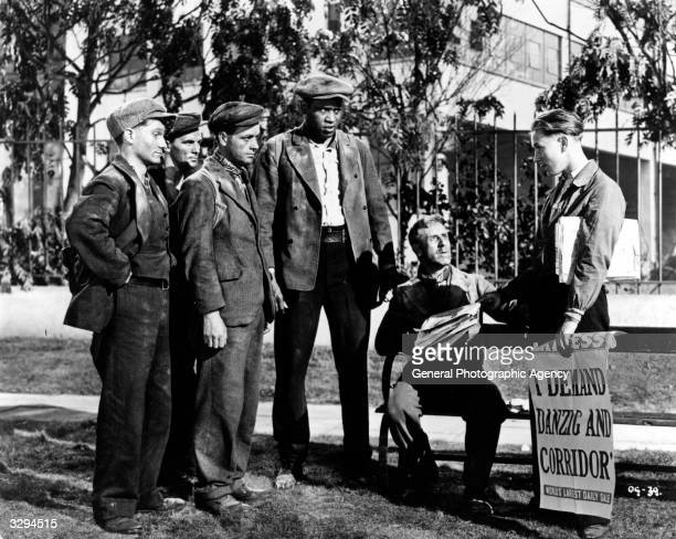 Paul Robeson Simon Lack Jack Jones Charles Williams and Clifford Evans stand next to producer Michael Balcon on the set of 'The Proud Valley'...